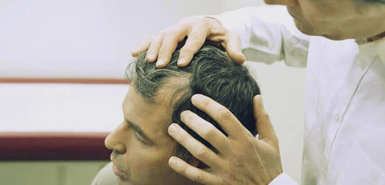 doctor is checking patient hair