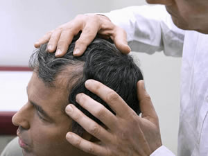 doctor checking patient hair